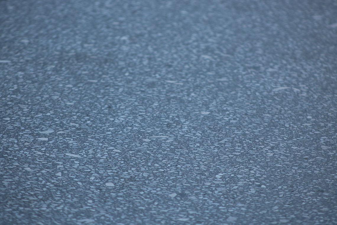 asfalto fundido pulido